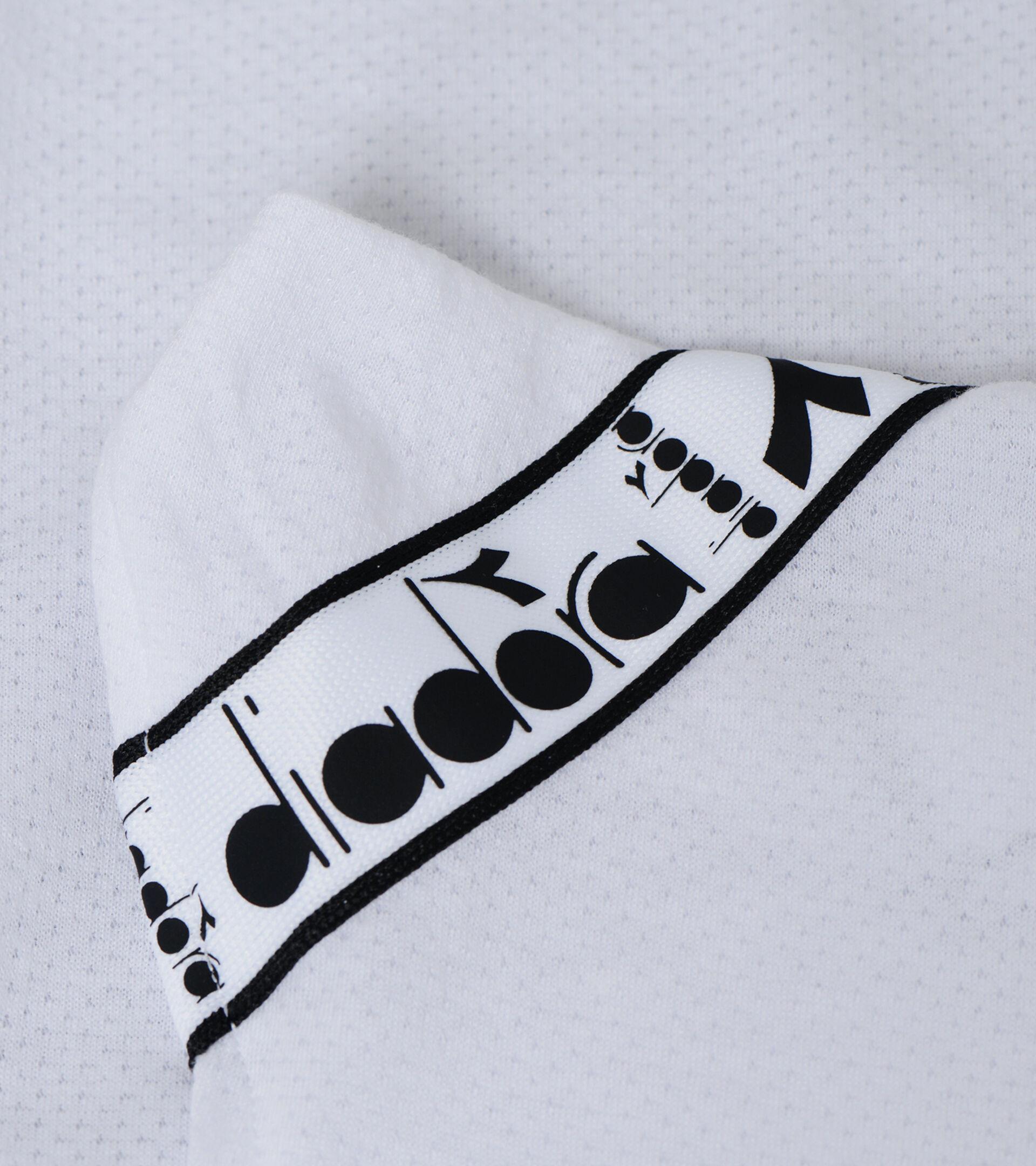 Camiseta de entrenamiento - Mujer L. TANK BE ONE BLANCO VIVO - Diadora