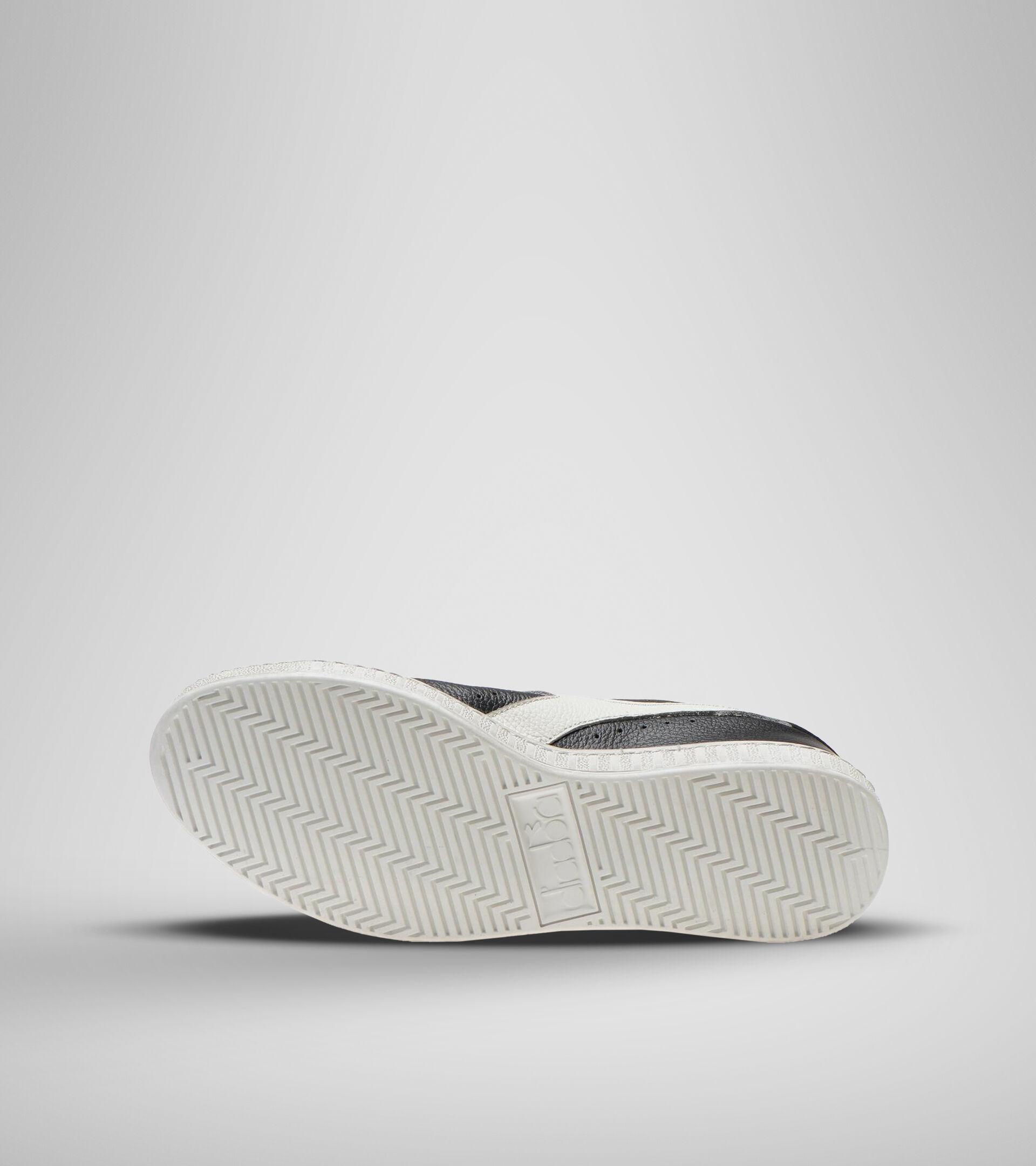 Sneaker - Unisex GAME L LOW WAXED SCHWARZ/WEISS - Diadora