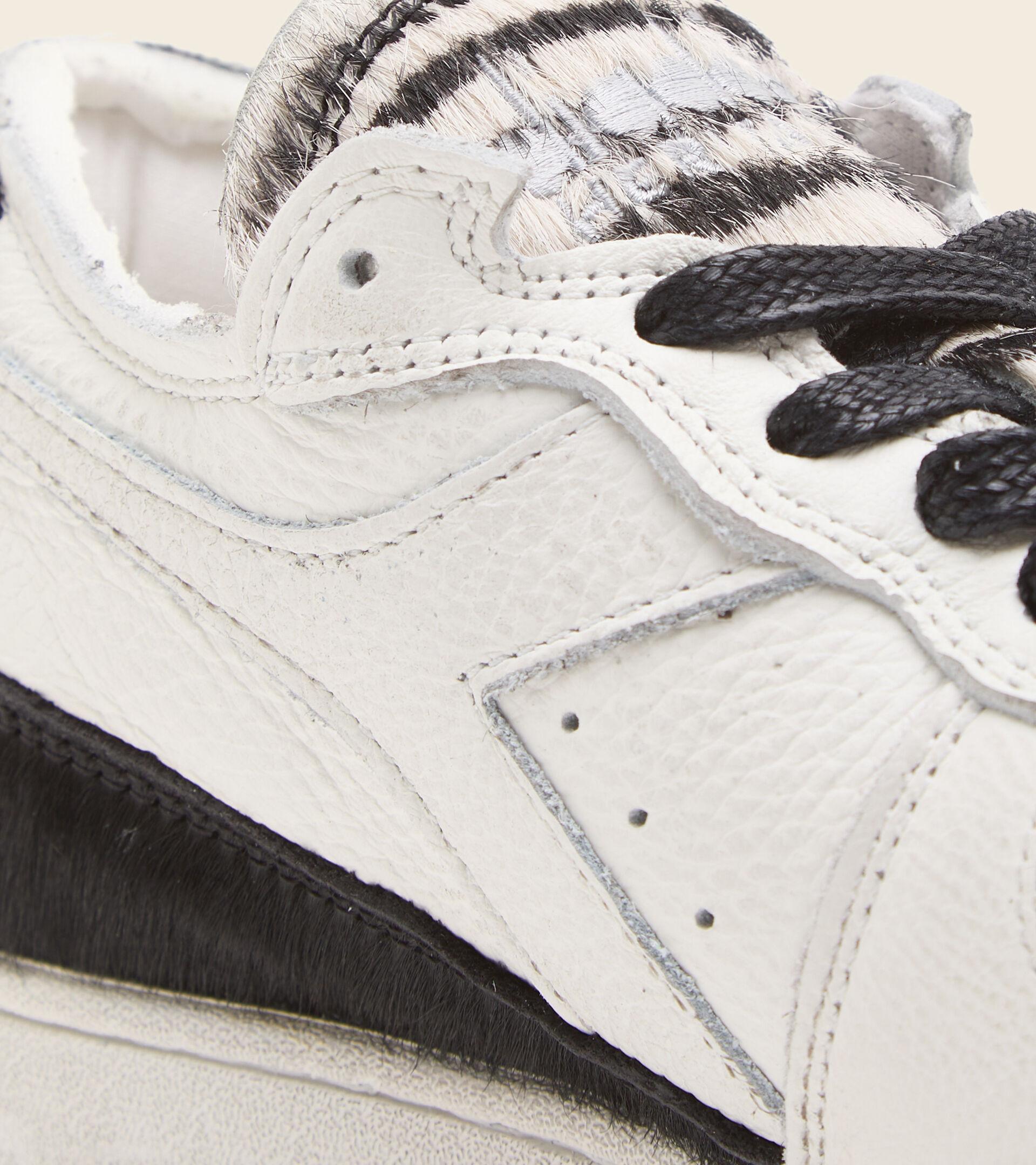 Footwear Heritage DONNA MI BASKET ROW CUT ZEBRA WN BIANCO/NERO Diadora